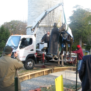 The 2,500 lb statue was lowered onto the prepared site.