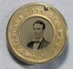 This tintype political button for the 1860 presidential race depicts a beardless Lincoln.