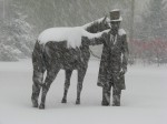The sculpture of Lincoln and his horse in driving snow